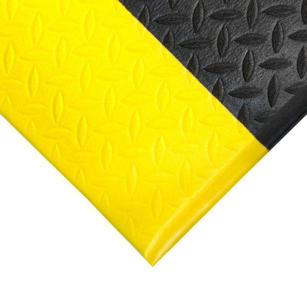 Černo-žlutá průmyslová protiúnavová protiskluzová pěnová rohož - délka 150 cm, šířka 90 cm a výška 0,9 cm FLOMAT